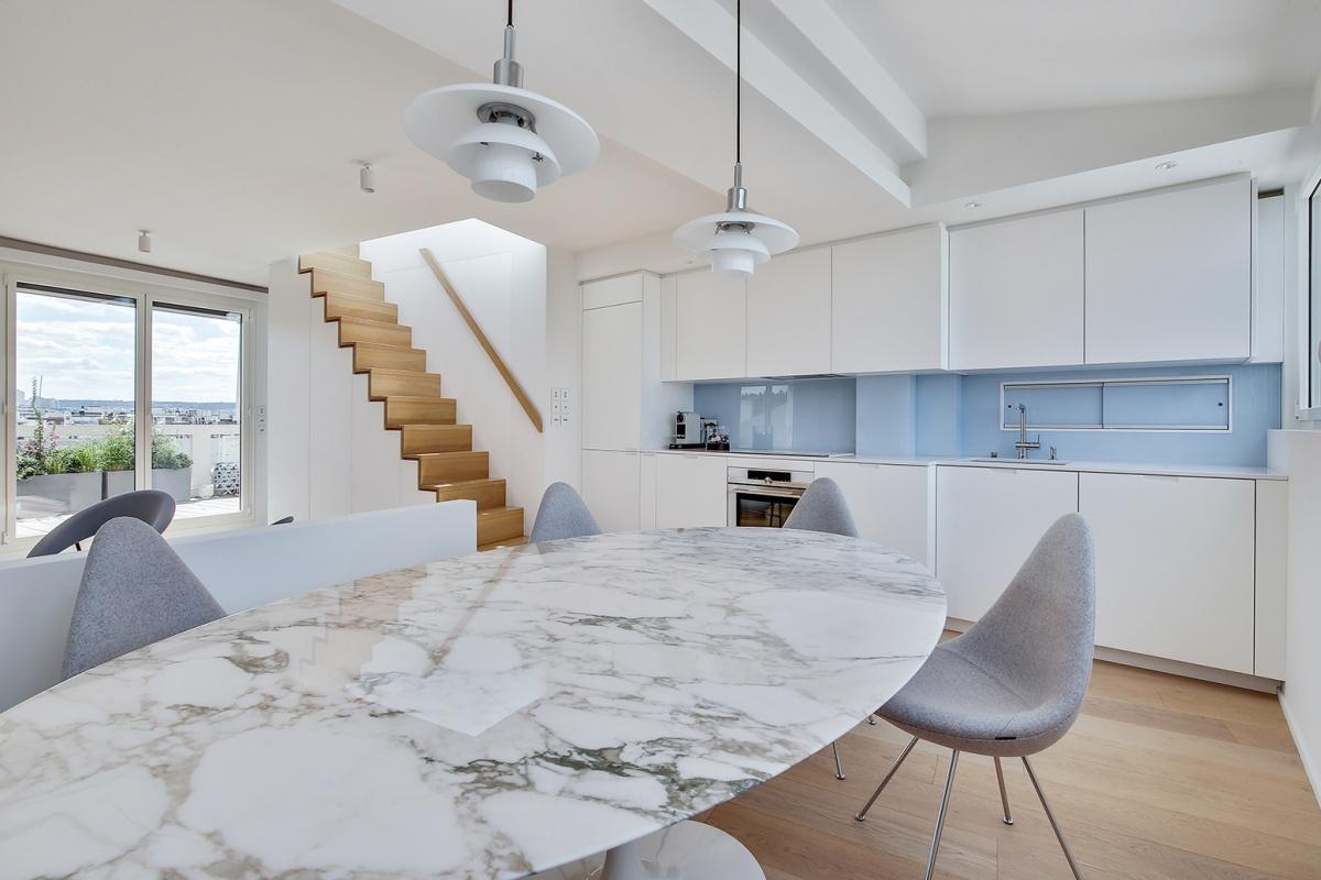 Réaménagement d'un appartement à Paris et création d'un rooftop